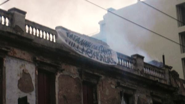 A banner reading 'Squat Forever – Villa Amalias' was placed on the roof